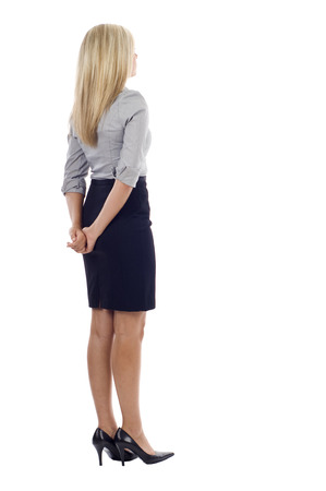 left behind: Business woman from the back - looking at something over a white background Stock Photo