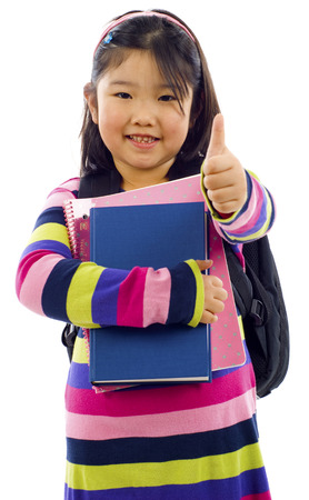 5 6 years: Friendly little  Asian student making thumbs up sign, Isolated over white