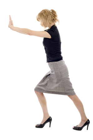 Business woman pushing an imaginary object isolated over a white background