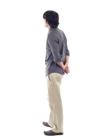 persona de pie: hombre de negocios de la parte posteriora - mirar algo sobre un fondo blanco