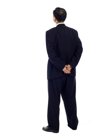 Senior Asian Business man from the back - looking at something over a white background Stock Photo