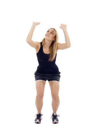 something athletic: Athletic woman pushing, lifting something up isolated over a white background