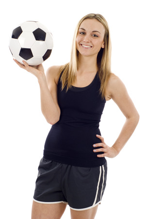 young girl feet: Young caucasian woman with soccer ball on white background
