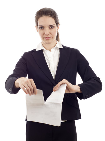 broken contract: Business woman with a serious expression as she tears up a contract isolated over white