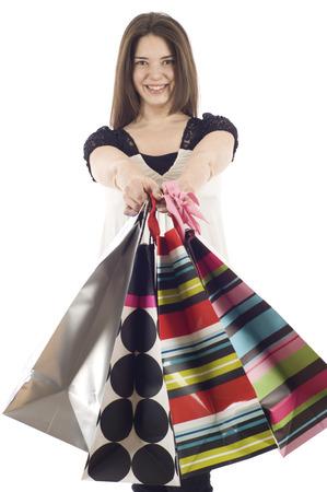 compras compulsivas: Hermosa mujer comercial aislada sobre un fondo blanco