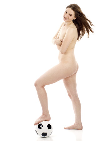 naked youth: Full length of a beautiful athletic naked woman with a soccer ball over white background