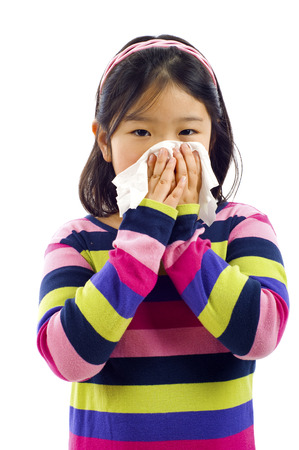 sniffle: Cute little Asian girl with the flu - isolated over white Stock Photo