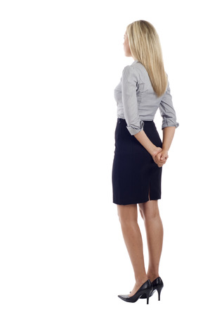 skirts: Business woman from the back - looking at something over a white background Stock Photo