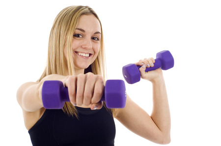 dumb bells: Woman doing fitness exercise isolated over white background.