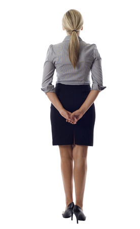 backwards: Business woman standing backwards isolated over white Stock Photo