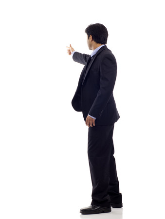 Full length of a Indian business man pointing at copyspace isolated over white background Stock Photo