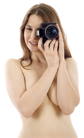 Attractive and sexy woman with camera isolated over white background photo