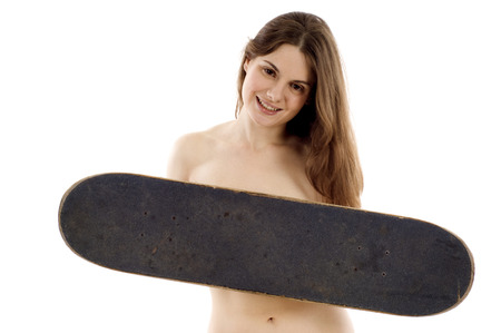 nude brunette: A beautiful young woman holding a old black skateboard isolated over white Stock Photo