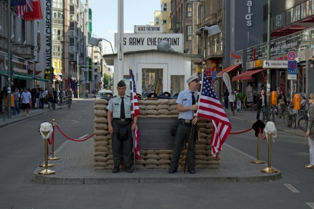 checkpoint: Berlin, Germany, 29 June 2012, One close-bitten and one smiling US solider at checkpoint charlie Editorial