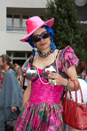 pink hat: Berlin Germany, June 23 2012, transvestite in pink dress and pink hat is posing infront of the camera at the Berlin Christopher street day parade Editorial