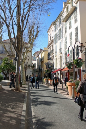 16th: Antibes, France, 16th February, 2013, People in the spring sun at Place National in Antibes
