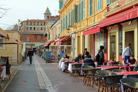 14th: Nice, France, 14th February, 2013, People gathering at a caf� in the emerging spring sun Editorial