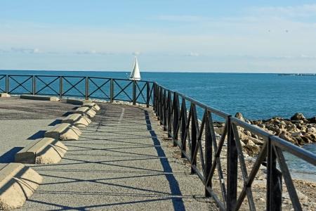 sailingboat: Antibes, France, 12th February, 2013, A sailingboat balancing on the guard rail