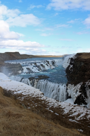 March 29th 2013, Gullfoss, Iceland, A large waterfall under a blue sky, vertical picture photo