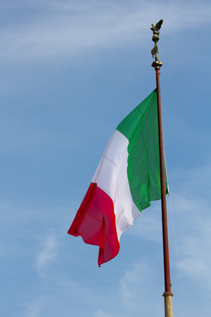 2014 30th March Rome Italy A close up of the Italian flag sagging against the blue sky photo