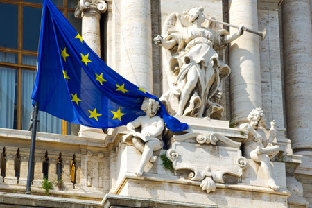 2014 30th March Rome Italy The flag of the european union is stuck over the shoulder of a small statue character