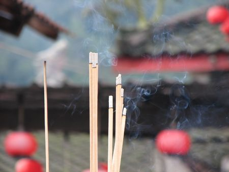 Burning joss sticks outside of a Chinese temple. photo