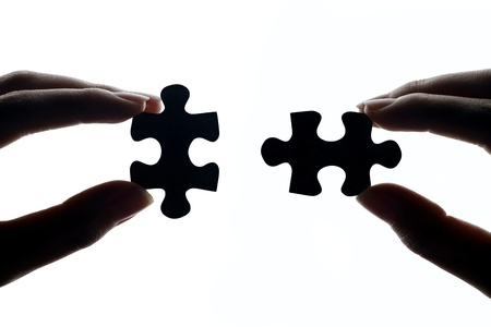 hands connecting jigsaw puzzle pieces stock photo picture and