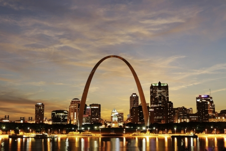 City of St  Louis downtown with Gateway Arch at twilight, Missouri