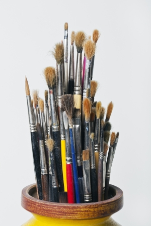 A lot of used paint brushes in a jar. Stock Photo