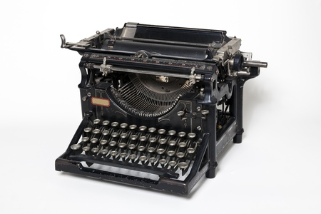Old antique typewriter on a white background