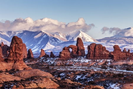 Turret Arch with Snow Mountains at sunset  Arches National Park, Utah
