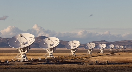 array: Very Large Array satellite dishes at Sunset in New Mexico, USA