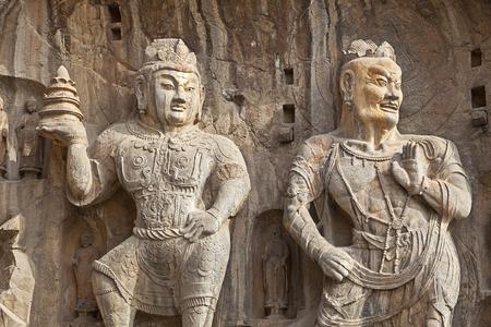 A shot of Chinese Buddha Statues in China photo