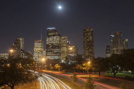 Houston Skyline at Night with Moving Traffic, Texas, USA Stock Photo