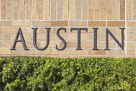 Austin Text Sign Mounted on a Brick Wall