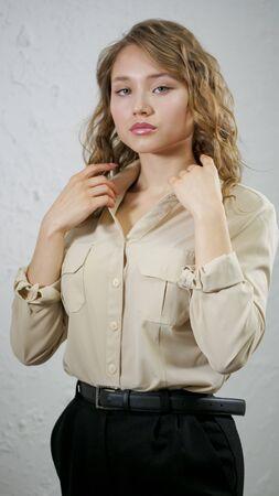 Portrait of blonde girl. Model posing for a photographer. Zdjęcie Seryjne