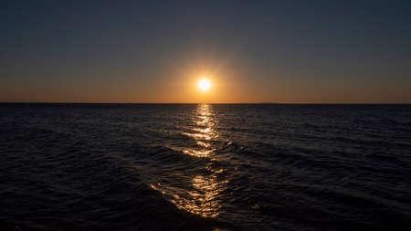 Sunset on the sea. Path of light on sea water. Zdjęcie Seryjne