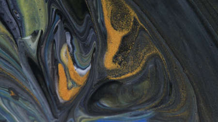 Abstract colorful background of spreading colors. Abstract dark paint background. Zdjęcie Seryjne