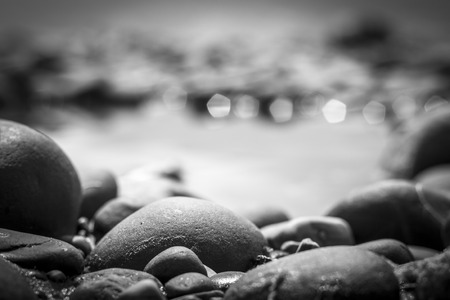 Stones and pebbles on a water background