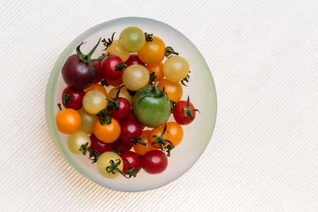 many tomato such as a jewel served in white porcelain  Stock Photo