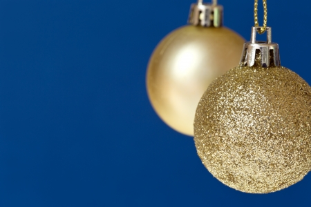 lame: Christmas balls hanging on blue,with copy space to the left