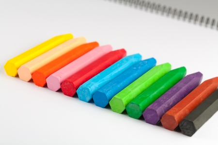 Multicolored crayons on a sketch book photo