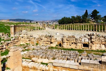 greco roman  roman: Oval forum, Roman ruins in the city of Jerash Stock Photo