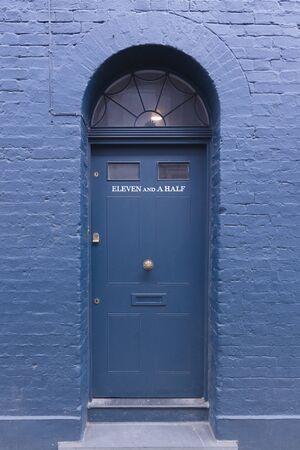 Eleven and a half, Door on Fournier Street near Spitalfields market, London, England