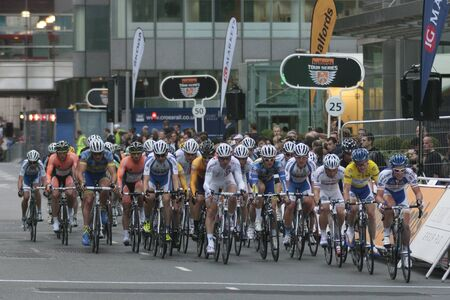 Cyclists racing, Halfords Tour Series Race at Canary Wharf, London, England