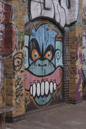 Graffiti of an angry monkey along the Regent's Canal near Acton's Lock, Hackney, London, England, United Kingdom Stock Photo