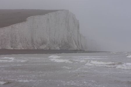 Seven Sisters cliffs in the rain from Cuckmere Estuary, East Sussex, England, United Kingdom