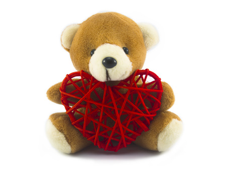 cute teddy bear and red heart isolated on white background with clipping path. 免版税图像