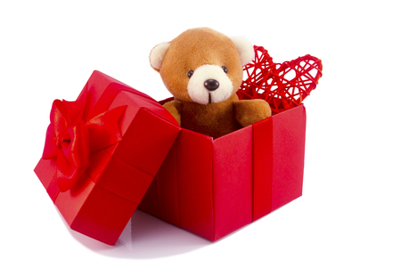 cute teddy bear and red heart in red gift box on white background with clipping path,too give someone important in valentine's day.