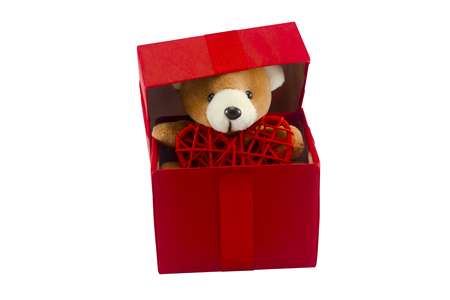 cute teddy bear and red heart in red gift box isolated on white background with clipping path,too give someone important in valentine's day.